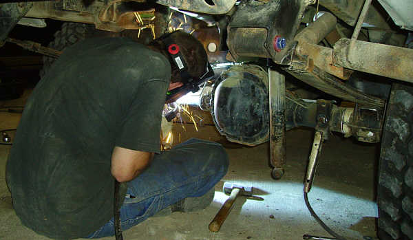The Ho - Andy welding new rear shock absorber bolts